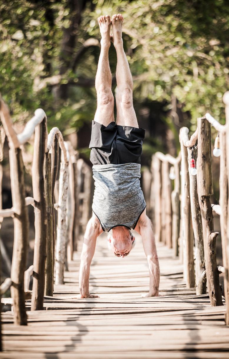Simon  Borg-Olivier in a handstand, Goa, India